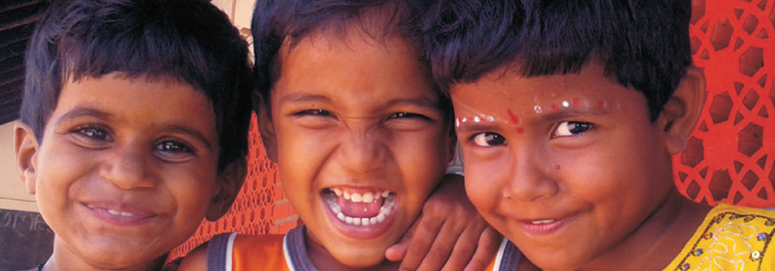 Headshots of three children from one of Reaching the Unreached