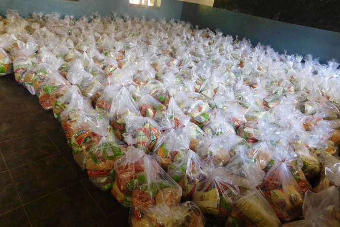 Sacks of emergency dry ration packs waiting to be delivered