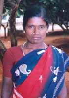 Pothumani, smiling in her blue and white dress and red sari