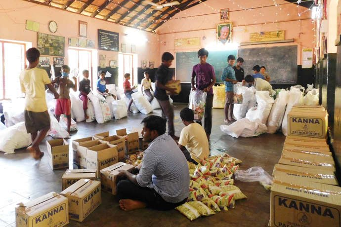 Hostel boys helping to package up the dry ration packs at RTU