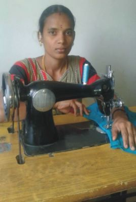 New entrepreneur Saranya, trained to be a tailor by Reaching the Unreached, sewing at her machine