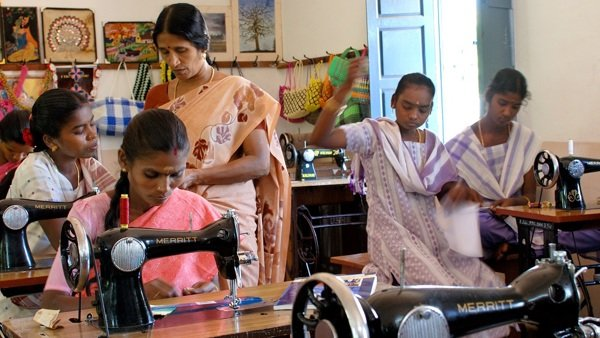 Tailors trained by Reaching the Unreached at their sewing machines