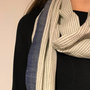 Organic cotton scarf in blue and cream with a blue running stitch